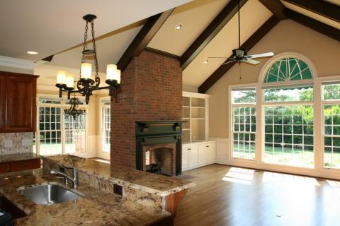 Traditional Family Room with candle and iron chandelier