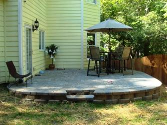 Retaining Wall With Grading And Raised Paver Patio