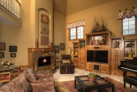 Traditional Family Room with black wood coffee table with glass panel top