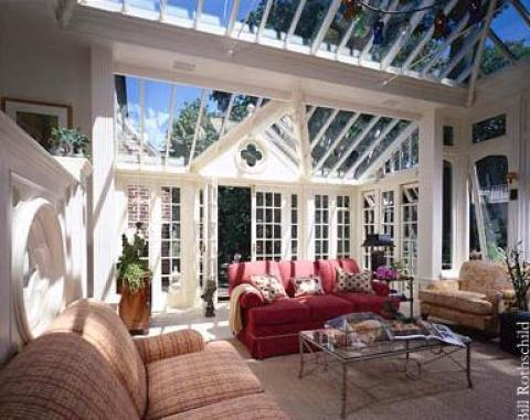 Eclectic Sunroom with glass and metal coffee table