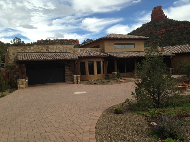 Mediterranean home exterior in prescott stone siding for Prescott architects