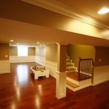 Traditional Basement with light brown painted walls