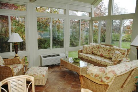 Traditional Sunroom with wicker furniture