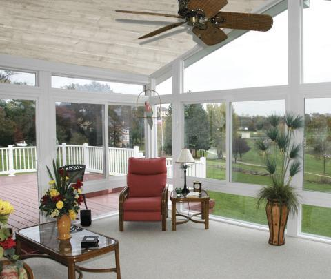 Traditional Sunroom with dark wood coffee table with glass top