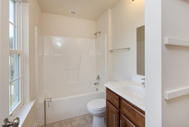 Traditional Bathroom in Fredericksburg tile floor