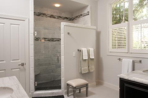 Transitional Bathroom with black and gray accent shower wall trim