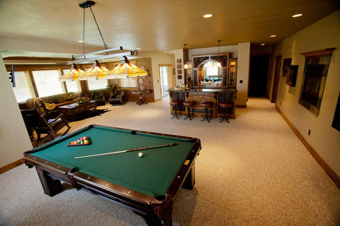 Traditional Basement with wall to wall carpet