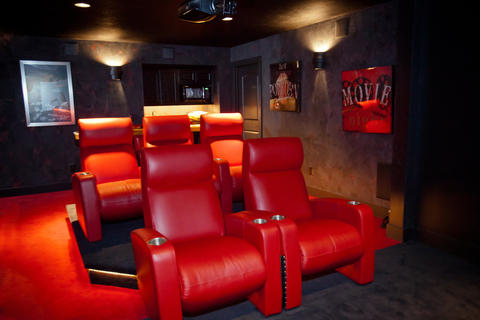 Modern Home Theater with red leather chairs