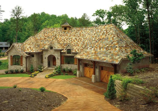 Cottage Home Exterior in Dallas - painted cement driveway
