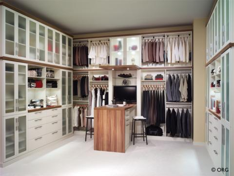 Contemporary Closet with custom built closet organization storage units