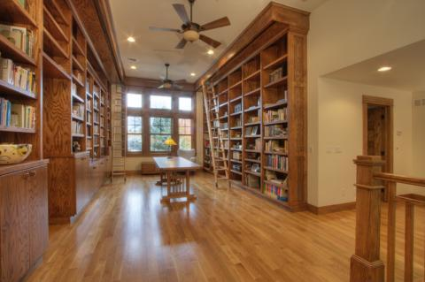 Traditional Library with custom full wall book cases