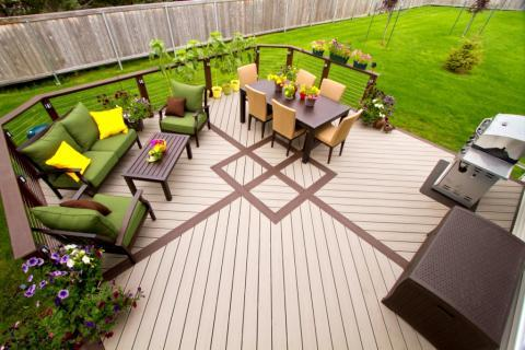 Contemporary Patio with metal and wood deck railing