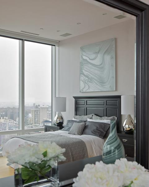 Eclectic Bedroom with large floor to ceiling windows