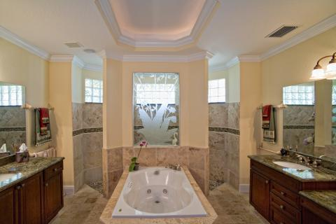 Transitional Bathroom with tan porcelain tile shower wall covering