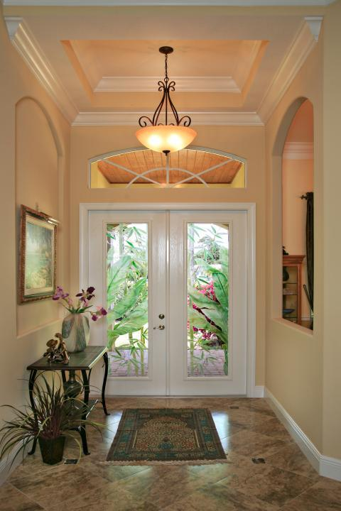 Traditional Entry with black metal hallway table with tile surface