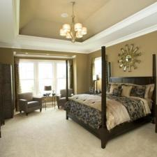 Transitional Bedroom with bedside table lamps with tan shades