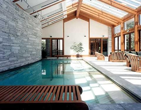 Transitional Pool with light wood framed windows and doors