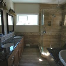 Traditional Master Bathroom with glass shower stall walls and door