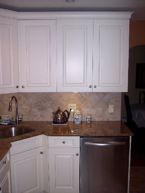 transitional kitchen in milton brown granite countertop stainless steel appliances by. Black Bedroom Furniture Sets. Home Design Ideas