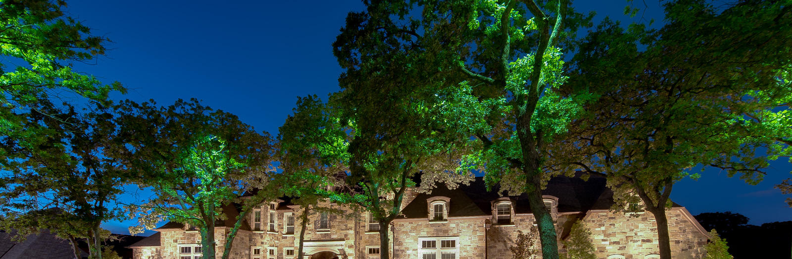 French Country Landscape with green tint landscape lighting