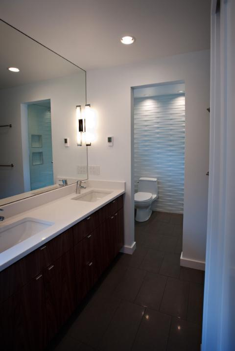Contemporary Master Bathroom with dark wood vanity cabinet