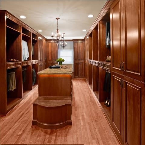 Traditional Closet with brown granite counter tops