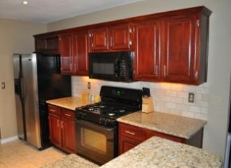 Kitchens with granite stainless and more pictures and photos for Bombay mahogany kitchen cabinets
