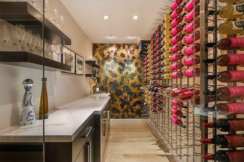 Contemporary Wine Cellar with gold textured accent wall