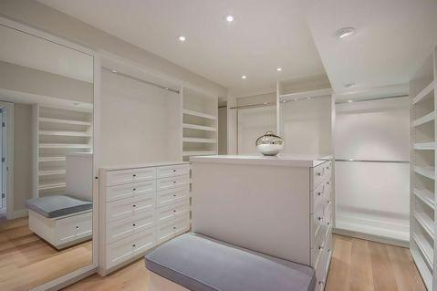 Contemporary Closet with light hardwood floor