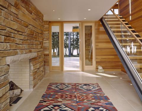 Eclectic Entry with light horizontal wood wall paneling