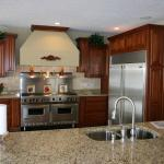 Transitional Kitchen with brushed nickel pull out faucet sprayer faucet