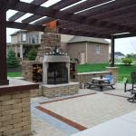 Contemporary Fireplace with multi toned patio flooring