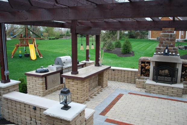 Traditional Outdoor Kitchen with stained concrete counter tops