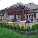Transitional Patio with dark brown brick home exterior accent