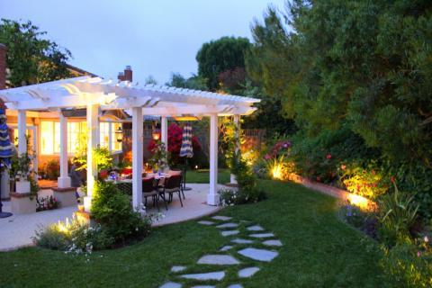Cottage Patio with light design between landscape