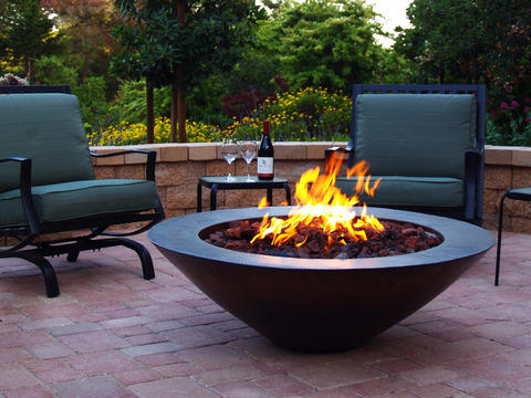 Patio with black cast iron fireplace