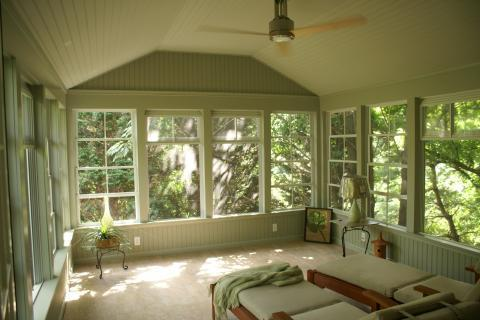 Traditional Sunroom with light wood lounge furniture