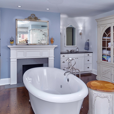 Eclectic Bathroom with tub in the middle of the room