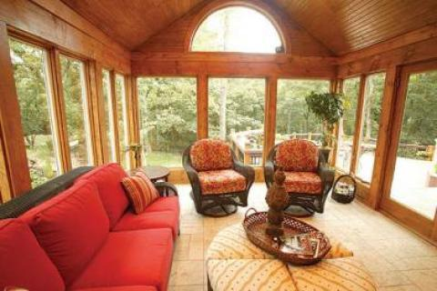 Traditional Sunroom with light wood plank ceiling covering