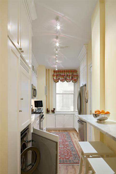 Eclectic Laundry Room with stackable washer and dryer