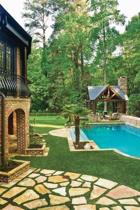 Transitional Pool with covered sitting area around the fireplace