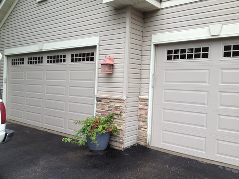 Traditional Garage with gray panel garage door