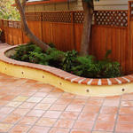 Transitional Patio with red tile flower bed trim