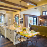 French Country Kitchen with stained wood ceiling beams