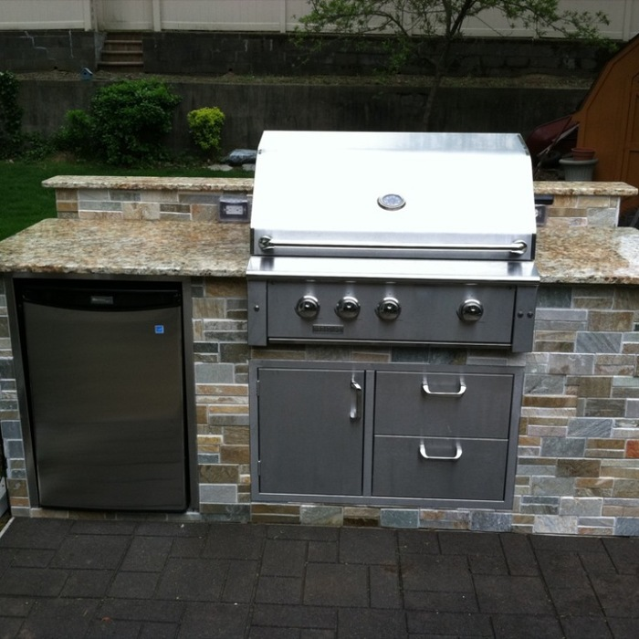 Outdoor kitchenette with grill and mini-fridge