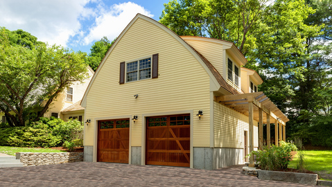 Arts & Crafts Garage with craftsman style garage doors