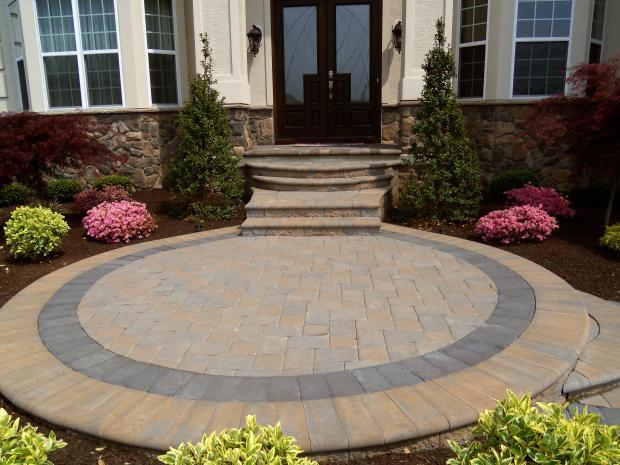 Traditional Patio with cobblestone accent siding