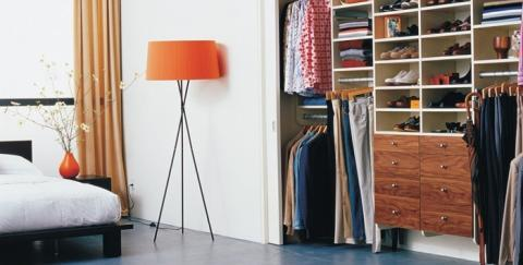 Transitional Closet with tri pod floor lamp with orange shade