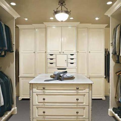 Traditional Closet with closet island with white counter top