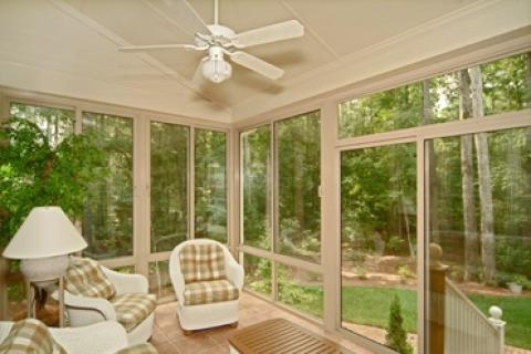Transitional Sunroom with white wicker furniture
